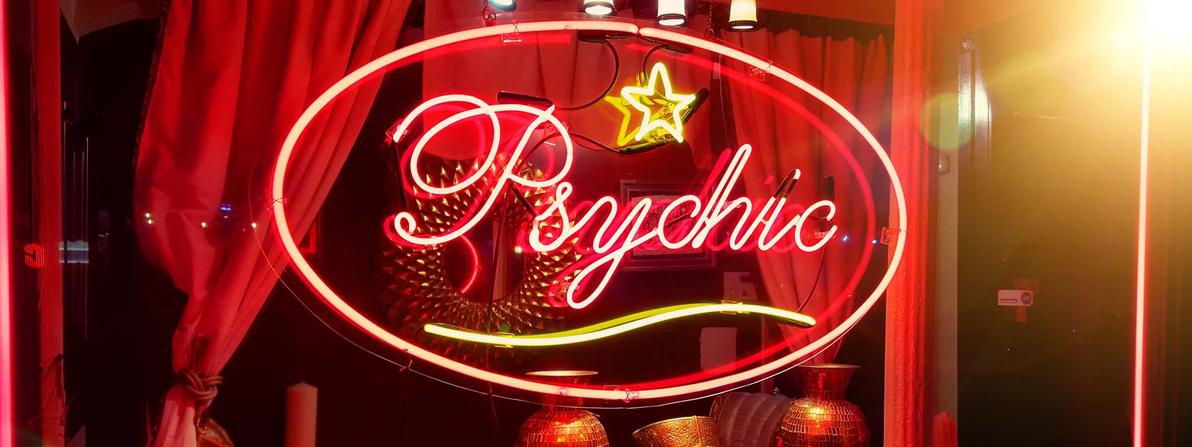 """Neon sign that says """"psychic""""."""