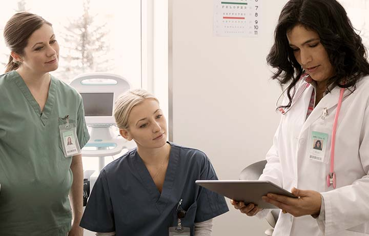 image of a female physician with two members of a care team