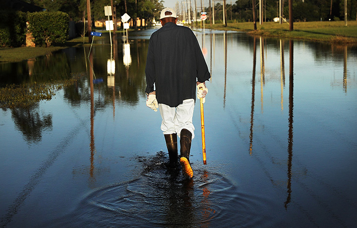Man walking in flood waters