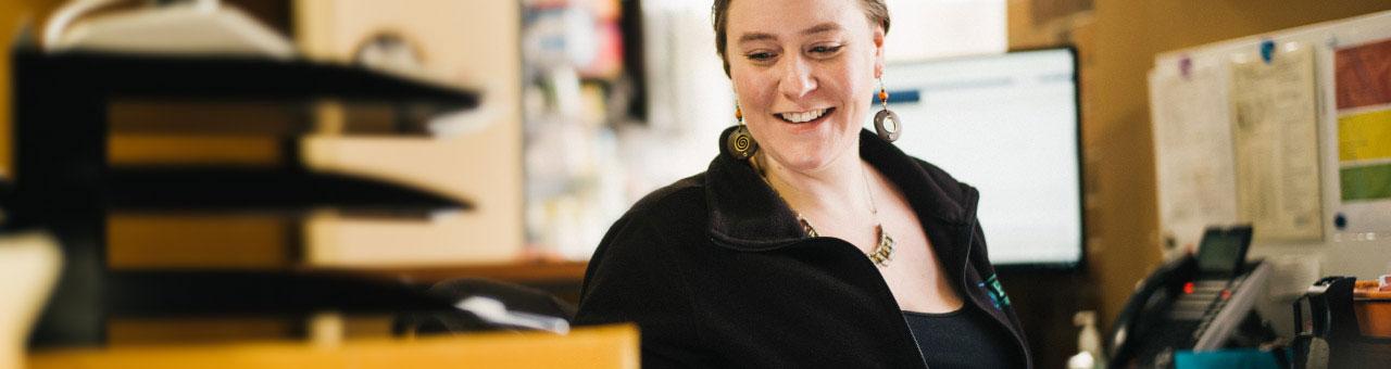 female administrator at front desk